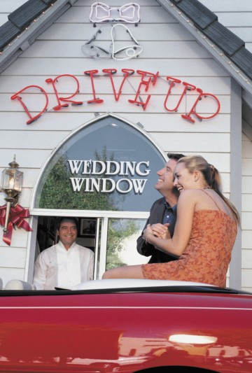 ca. 2000 --- Bride and Groom Outside a Drive-in Church --- Image by © Royalty-Free/Corbis
